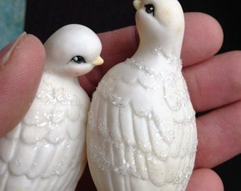 Two small bisque doves with glass glitter