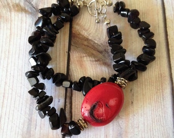 Black Glass and Red Turquoise bracelet