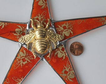 Bee Love star- lacquered paper on glass points with brass bee center- 9.5 inches