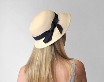 40's panama hat. straw. 1940's cream hat. navy blue ribbon. brim. summer. 40 women's panama. knox.