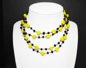 Downton Abbey Costumes Ideas Black  Yellow Flapper Necklace  Yellow Rose Flower Beads  Black Ball Beads  Brass Link Chain  Art Deco Style Rope length $26.00 AT vintagedancer.com