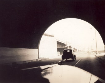 Abstract Photo of CAR LEAVING TUNNEL Photo Circa 1940s