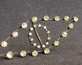 Antique metal and rhinestones precious jewelry buckle.