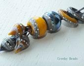 Handmade Lampwork beads, discs sliders and headpins - Creeky Beads SRA