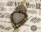 Milagro necklace sacred heart religious ex voto rhinestone metallic trim red and green stones one of a kind jewelry assemblage