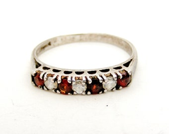 Vintage sterling silver garnet and synthetic spinel half eternity ring.