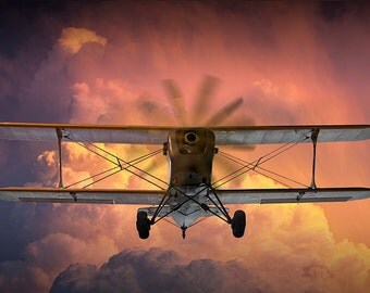 Loud Planes Fly Low with a Classic Vintage Biplane with Brilliant Storm Clouds at Sunset No.3836 A Fine Art Aviation Photographic Image