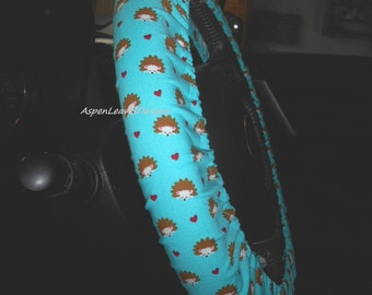 Steering wheel cover. Small hedgehogs on blue. Fabric car accessories.