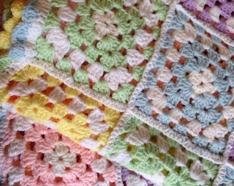 Pastel granny squares afghan with scalloped edge