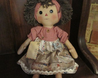 Primitive Raggedy Ann with vintage postal envelope dress