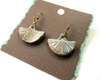 Earrings Ginkgo Leaf Impression in Clay in Gold color on Patina Hung on gold plated stainless steel