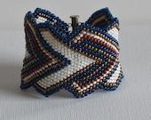 Native American bracelet, indigo, rust, gold and cream