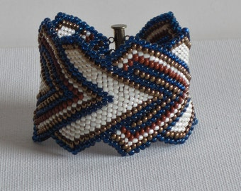 Native American bracelet in indigo, rust, gold and cream