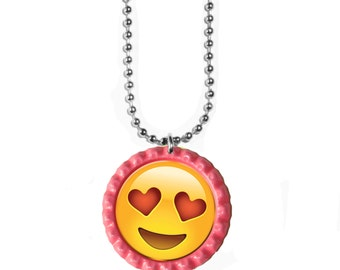 Emoji Necklace with Bottlecap charm. You choose the Emoji and the bottlecap color. Has an 18 inch necklace.