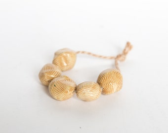 Years of Rice and Salt  -- a set of 5 rustic textured handmade ceramic beads in caramel
