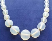 1940s Costume Jewelry: Necklaces, Earrings, Brooch, Bracelets SALE1940s  Opal Glass Necklace Opaque Frosted Opalite 19 inch long Gold tone Moonstone like $29.00 AT vintagedancer.com