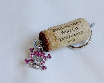 Cork Keychain with a Pink Rhinestone Skull and Cross Bones Hanging Charm