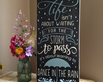 READY TO SHIP Life Isn't About Waiting For The Storm To Pass Distressed Wood Sign