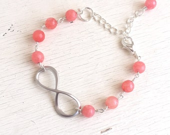 Infinity and Coral Pink Beaded Bracelet in Silver. Beaded Bracelet.  Gemstone Bracelet.  Coral Silver Infinity Bracelet. Gift for Her.