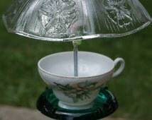 up cycled ash tray and teacup, hanging bird feeder