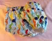 SassyCloth one size pocket diaper with geekly mustaches on baby blue cotton. Ready to ship.