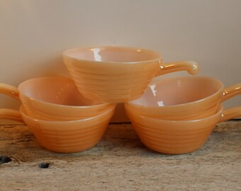 5 Fire King orange luster bowl with handle. Oven proof dish.