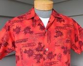 vintage 1960's Men's Hawaiian short sleeve shirt. Pineapple & Flower tribal design print on Orange cotton. Medium