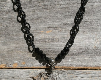 A rayon chain and skull necklace