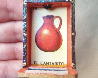 Nicho Ornament - El Cantarito. Orange and Gold with Glass Bead. Colorful glittery accents, mini serape. Loteria art.
