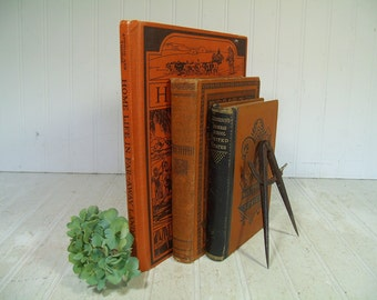 Antique History & Geography Schoolbooks Set of 3 Ornate Orange and Black Embossed Hard Covers - Decor or Prop Books Cinnamon Collection of 3