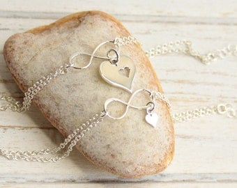 Sterling Silver Mother and Daughter Infinity Cut Out Heart Bracelet Set...