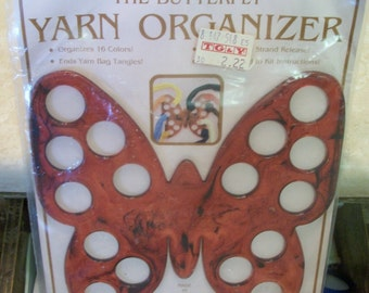 The Butterfly Yarn Organizer tortoise-shell plastic