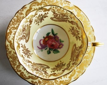 Paragon Teacup and Saucer, Yellow and Gold Floral