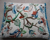 Jacobean embroidery made into a cushion cover bobble edged