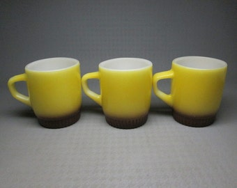 set of three Anchor Hocking FIRE KING stacking mugs yellow and brown