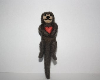 small needle felted otter with heart