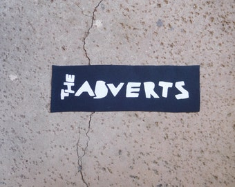 The adverts sew on patch; punk band patch
