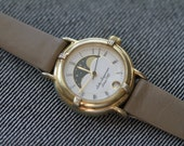 Vintage womens Jules Jurgensen quartz watch moon phase with date gold tone moved strap