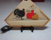 Cute and colorful unused art deco 1930's Buzza  parchment paper thanksgiving bridge tally turkey watches pilgrim girl sit on pumpkin eating