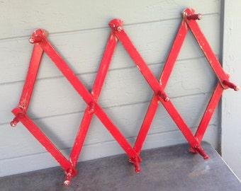 Vintage red accordion rack peg rack wood peg rack,  accordian peg rack