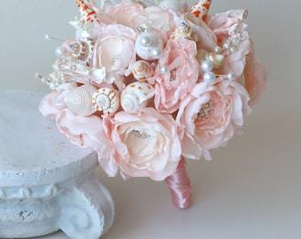 Seashell wedding bouquet . Petal pink seashell wedding bouquet. Pink beach wedding bouquet
