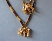 Gold elephant set .Ethnic safari style.Real 14K gold necklaces and bracelet