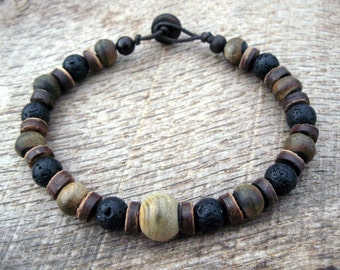 Mens tribal bracelet, horn, black lava stone and coconut shell beads, handmade, strong cord with toggle and loop clasp, surfer style