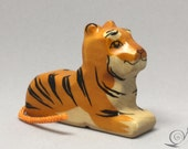 Toy Tiger Baby woodencolurful orange black stripes lying Size 7,0 x 6,0 x 2,0 cm (bxhxs) approx. 33,0 gr.
