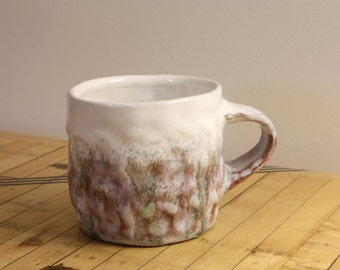Grey and milky white ceramic cup