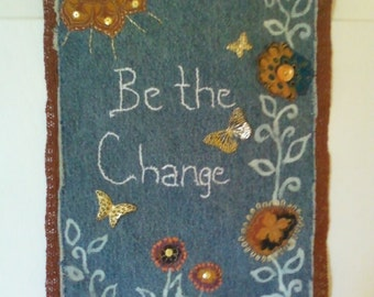 """Recycled Denim Wall Hanging with """"Be the Change"""" quote."""