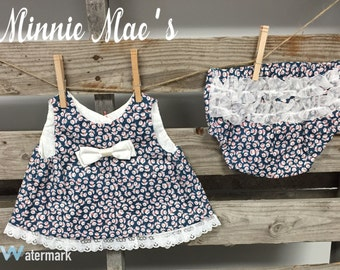 Navy Tulips Button Back Dress and Ruffled diaper cover.
