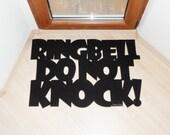 Door mat with message: Ringbell, do not knock! . Custom floormat phrase