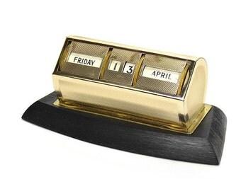 Vintage Gilt Engine Turned Perpetual Desk Calendar on a Black Base