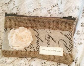 Burlap pouch with script trim